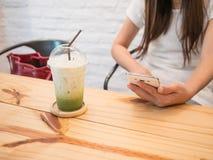 Ice green tea  on wood table. Royalty Free Stock Image