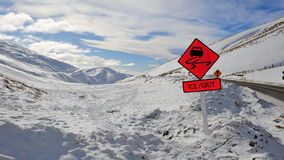 Ice and grit warning sign. Signs warning drivers of ice and grit on snow mountain roads in New Zealand Stock Images