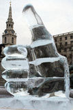 Ice hand. Hand made of ice against a church tower in a London stock image