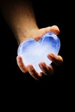 Ice heart. Concealing ice heart in hands Royalty Free Stock Images