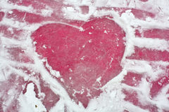 Ice heart. Heart on the surface of an glamour pink ice rink Royalty Free Stock Photos