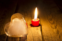 Ice heart and candle abstract Valentine s Day concept. In night Stock Photos