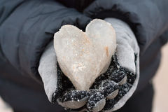 Ice heart in hands Royalty Free Stock Photo