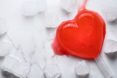 Ice heart melting. Red ice heart melting with ice cubesn Royalty Free Stock Images