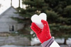 Ice heart in red glove Stock Photo