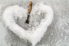 Ice in heart shaped. And chisel 2 Stock Photos