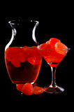 Ice hearts and kool-aid. A pitcher of kool-aid and ice hearts royalty free stock photo