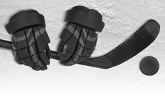 Ice Hockey Accessories Set. Hockey gloves, putter and washer on the ice of the hockey field. Concept, hockey Stock Photos