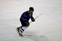 Ice Hockey Action. Hockey player skating towards puck stock images