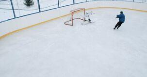 YAROSLAVL, RUSSIA - JANUARY 29 2015:hockey action shot with forward player and goalie. Young teenagers play hockey in