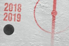 Ice hockey arena with a marking and a washer. Fragment of ice hockey arena with a puck. Hockey, season, concept stock photos