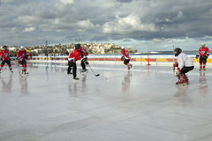 Ice hockey on a beach Stock Image