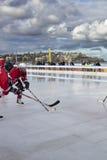 Ice hockey on a beach Stock Images