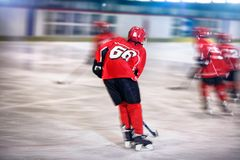 Ice hockey- boy skating on the rink stock images