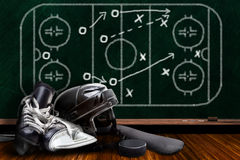 Ice Hockey Equipment and Chalk Board Play Strategy Royalty Free Stock Image