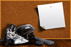 Ice Hockey Equipment and Cork Board Copy Space Stock Photography