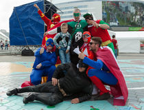 The ice hockey fans in superheroes costumes Royalty Free Stock Photo