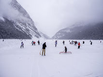 Ice hockey on frozen Lake Louise in Banff Royalty Free Stock Photography