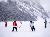 Ice hockey on frozen Lake Louise in Banff Stock Image