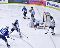 Ice hockey game. The Goalie is blocking a puck with stick in the game in Bangkok Stock Image