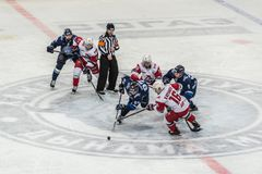 Ice hockey game, players and referee stock image