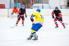 Ice hockey game on rink. Unrecognizable ice hockey player with stick in attack. Ice hockey game on rink stock photos