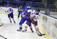 Ice-hockey game between Ukraine and Romania Stock Photos