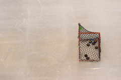 Ice hockey goal with copy space on ice skating rink texture background Stock Photos