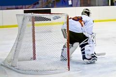 Ice hockey goalie. Hockey goalie in generic white equipmant protects gate Royalty Free Stock Image