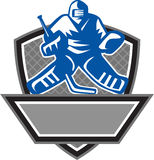 Ice Hockey Goalie Crest Retro. Illustration of a ice hockey goalie wearing helmet holding hockey stick set inside shield crest viewed from the front with net on Royalty Free Stock Image