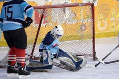Ice hockey goalie in front of his net. Picture taken in ice arena. royalty free stock images