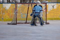 Ice hockey goalie in goal face blurred . royalty free stock photos