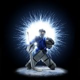 Ice Hockey goalkeeper on a abstract background. Ice Hockey goalkeeper is on a abstract background with intensional light Stock Image