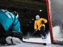 Ice hockey goalkeeper. Player on goal in action Stock Photo