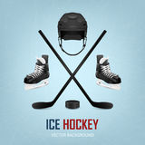 Ice hockey helmet, puck, sticks and skates. Royalty Free Stock Images