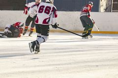 Ice hockey match, players of both teams compete on the championship f royalty free stock images