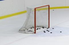 Ice Hockey net. An Ice Hockey net with some pucks Royalty Free Stock Photography