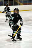 Ice hockey player. Youth ice hockey player in action with some motion blur royalty free stock photography