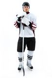Ice-hockey player. Portrait of ice-hockey player with hockey stick royalty free stock photography