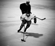 Ice hockey player. Skating with the puck royalty free stock photography