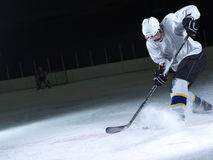 Ice hockey player in action. Kicking with stick Stock Image
