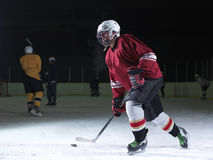Ice hockey player in action Royalty Free Stock Photos