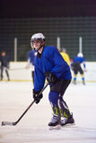 Ice hockey player in action Stock Photos