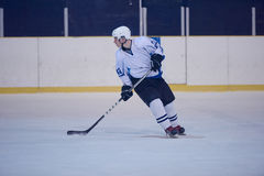 Ice hockey player in action Royalty Free Stock Image
