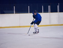 Ice hockey player in action Royalty Free Stock Images