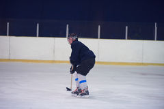 Ice hockey player in action Stock Photography