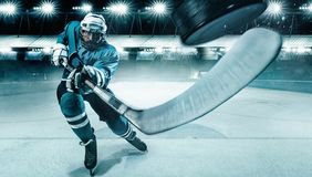 Ice Hockey player athlete in the helmet and gloves on stadium with stick. Action shot. Sport concept. Hockey player in the mask on stadium royalty free stock image