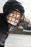Ice hockey player boy. Royalty Free Stock Image