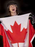 Ice hockey player with canadian flag Stock Photo