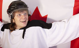 Ice hockey player with canadian flag Stock Images